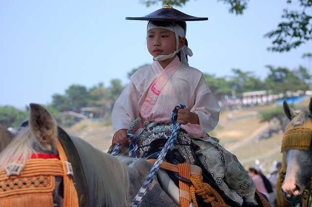 A child riding a horse at Soma Nomaoi